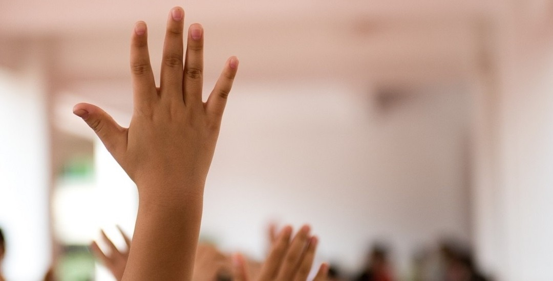 Childs hand up in the classroom